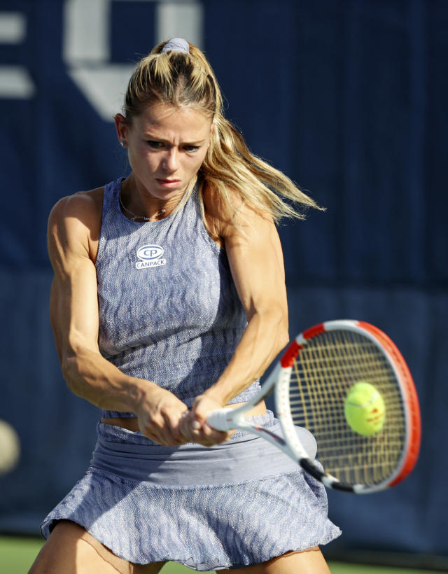 Camila Giorgi, of Italy, returns a shot to Maria Sakkari, of Greece, during the first round of the US Open tennis tournament Monday, Aug. 26, 2019, in New York. (AP Photo/Michael Owens)