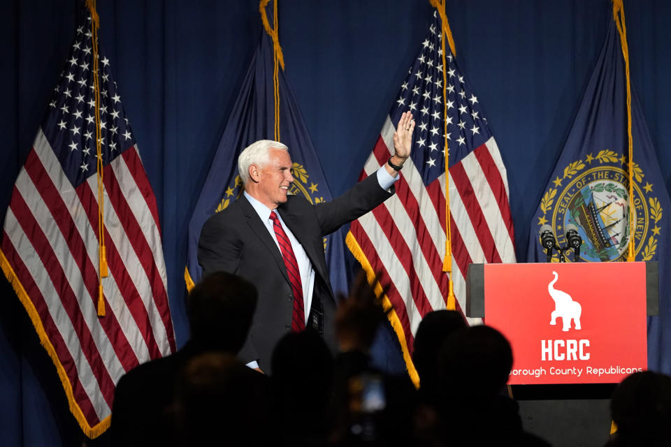 Former Vice President Mike Pence waves after speaking at the annual Hillsborough County NH GOP Lincoln-Reagan Dinner, Thursday, June 3, 2021, in Manchester, N.H. (AP Photo/Elise Amendola)
