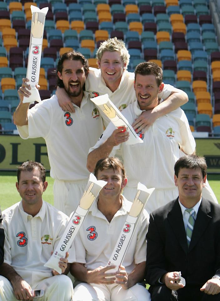 BRISBANE, AUSTRALIA - NOVEMBER 16:  Jason Gillespie, Michael Clarke and Michael Kasprowicz of Australia enjoy themselves before training at the 'Gabba November 16, 2004 in Brisbane, Australia.  (Photo by Hamish Blair/Getty Images)