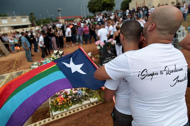 "<p>Friends of Jonathan Camuy, one of the victims of the shooting at the Pulse night club in Orlando, embrace during his funeral in his hometown of Camuy, Puerto Rico, June 22, 2016. The shirt reads, ""We will always remember you Jonathan"". (REUTERS/Alvin Baez) </p>"