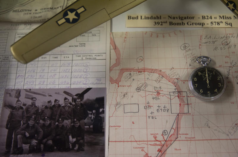 In this photo taken on Thursday, Nov. 7, 2019, a World War II model plane with navigation maps and a photograph are displayed at the Remember Museum 39-45 in Thimister-Clermont, Belgium. The museum houses countless World War II objects, but it's most important collection are stories and photos of those who served in World War II, mostly during the Battle of the Bulge. Veterans of the WWII Battle of the Bulge are heading back to mark, perhaps the greatest battle in U.S. military history, when 75-years ago Hitler launched a desperate attack deep through the front lines in Belgium and Luxembourg to be thwarted by U.S. forces. (AP Photo/Virginia Mayo)