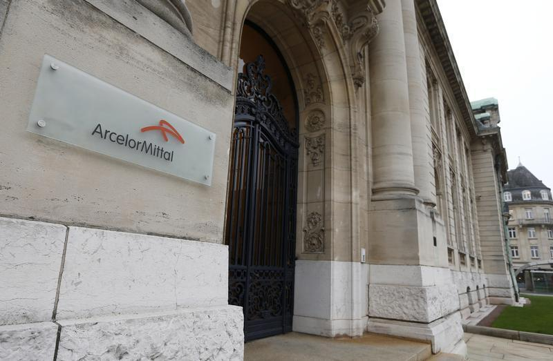 The logo of ArcelorMittal company is seen at the entrance of its headquarters in Luxembourg