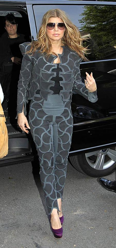 "Also looking a little like Spider-Woman this week? Fergie, who likes to push the envelope when it comes to fashion, but pushed it a little too far in this bizarre getup, which she inexplicably paired with purple pumps. KCSPresse/<a href=""http://www.splashnewsonline.com"" target=""new"">Splash News</a> - May 17, 2011"