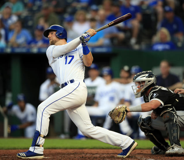 Kansas City Royals' Hunter Dozier (17) hits an RBI-double off Chicago White Sox starting pitcher Lucas Giolito during the fourth inning of a baseball game at Kauffman Stadium in Kansas City, Mo., Monday, July 15, 2019. (AP Photo/Orlin Wagner)