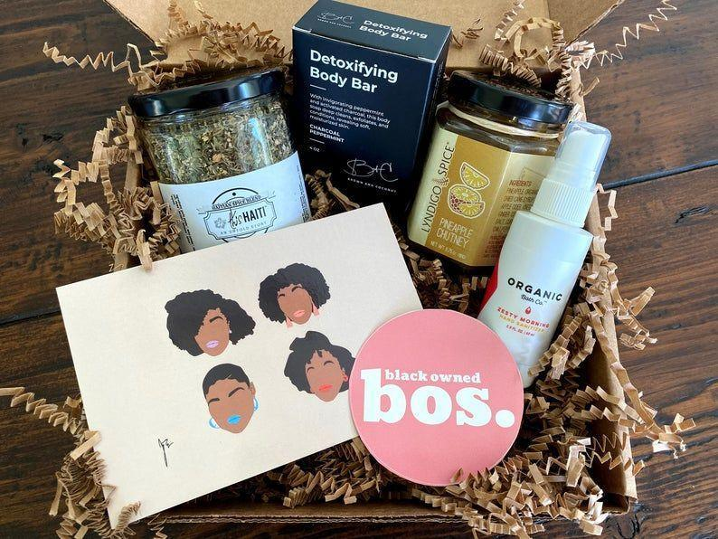 """<p><strong>LocalBostonGiftBoxes</strong></p><p>etsy.com</p><p><strong>$64.99</strong></p><p><a href=""""https://go.redirectingat.com?id=74968X1596630&url=https%3A%2F%2Fwww.etsy.com%2Flisting%2F871047001%2Fblack-owned-boston-gift-box&sref=https%3A%2F%2Fwww.womansday.com%2Frelationships%2Ffamily-friends%2Fg35756207%2Fmothers-day-gift-baskets%2F"""" rel=""""nofollow noopener"""" target=""""_blank"""" data-ylk=""""slk:SHOP NOW"""" class=""""link rapid-noclick-resp"""">SHOP NOW</a></p><p>If your mom is passionate about shopping local, then get her this small business gift set, which includes a curated selection of items from 7 Boston-based Black- and women-owned business. Items include a Haitian spice blend, pineapple chutney, a bath bar, lip balm, hand sanitizer, and a colorful art piece.</p>"""