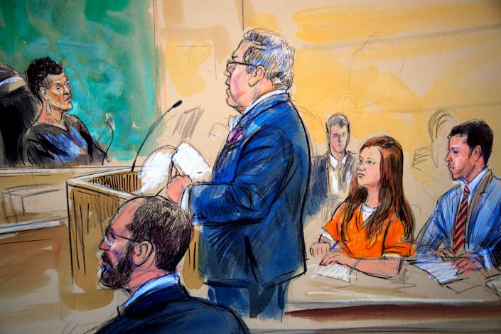 This courtroom sketch depicts Maria Butina, in orange suit, during a hearing in federal court in Washington, D.C., in July. (Photo: Dana Verkouteren via ASSOCIATED PRESS)