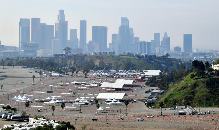 Vehicles make their way to a Covid-19 vaccination site at Dodger Stadium in Los Angeles, California on February 11, 2021, ahead of a temporary closure due to a shot shortage