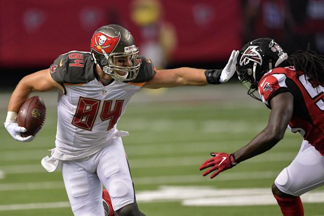 <p>Tampa Bay Buccaneers tight end Cameron Brate (84) straight arms Atlanta Falcons outside linebacker De'Vondre Campbell (59) during the first half at the Georgia Dome. Mandatory Credit: Dale Zanine-USA TODAY Sports </p>