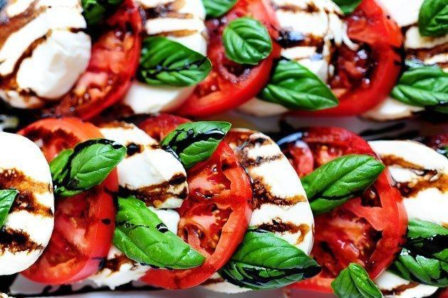 """<p>What's more classic than a Caprese salad? This one is perfect for any type of get-together.</p><p><strong><a href=""""https://thepioneerwoman.com/cooking/caprese-salad/"""" rel=""""nofollow noopener"""" target=""""_blank"""" data-ylk=""""slk:Get the recipe"""" class=""""link rapid-noclick-resp"""">Get the recipe</a>.</strong></p><p><a class=""""link rapid-noclick-resp"""" href=""""https://go.redirectingat.com?id=74968X1596630&url=https%3A%2F%2Fwww.walmart.com%2Fip%2FThe-Pioneer-Woman-Vintage-Floral-4-Piece-Dinner-Plate-Set%2F55467844&sref=https%3A%2F%2Fwww.thepioneerwoman.com%2Ffood-cooking%2Fmeals-menus%2Fg32157273%2Ffourth-of-july-appetizers%2F"""" rel=""""nofollow noopener"""" target=""""_blank"""" data-ylk=""""slk:SHOP PLATES"""">SHOP PLATES</a></p>"""