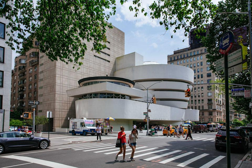 NEW YORK, NY - JULY 08: People pass the Solomon R. Guggenheim Museum on July 8, 2019 in New York City. Designed by architect Frank Lloyd Wright, UNESCO has named the building a world heritage site and is one of eight Wright properties to receive the honor. (Photo by Kevin Hagen/Getty Images)