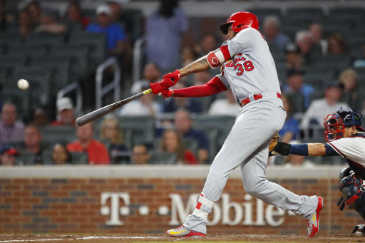 St. Louis Cardinals' Jose Martinez doubles in the eighth inning of a baseball game against the Atlanta Braves, Tuesday, Sept. 18, 2018, in Atlanta. (AP Photo/Todd Kirkland)