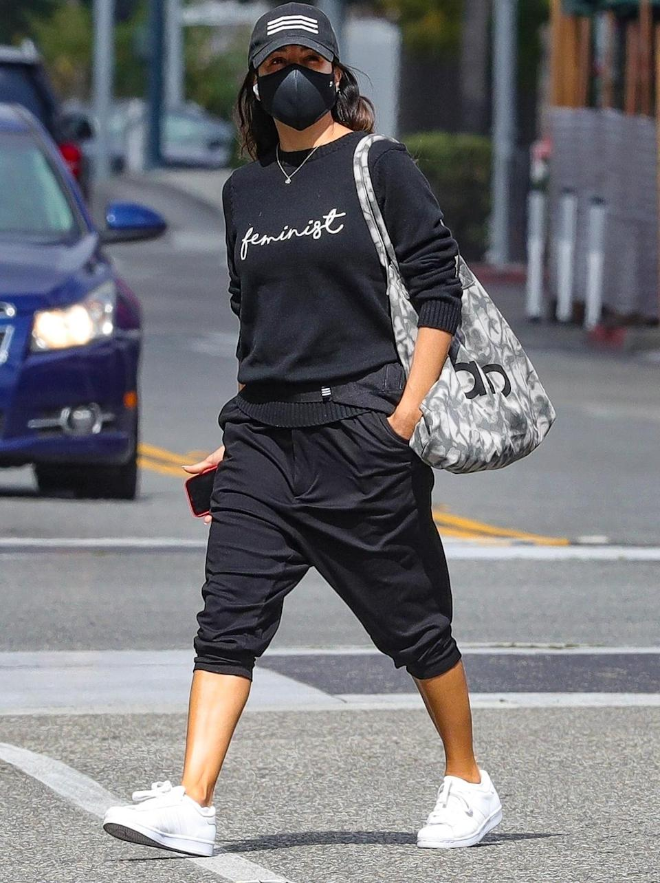 "<p>Eva Longoria wears a ""feminist"" sweater in celebration of International Women's Day while out shopping on Monday in Beverly Hills.</p>"
