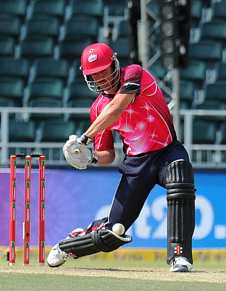 Sydney Sixers batsman Moises Henriques (C) plays a shot during a Group B  Match of The Champions League T20 (CLT20)  at Wanderers Stadium in Johannesburg on October 14, 2012. AFP PHOTO / ALEXANDER JOE