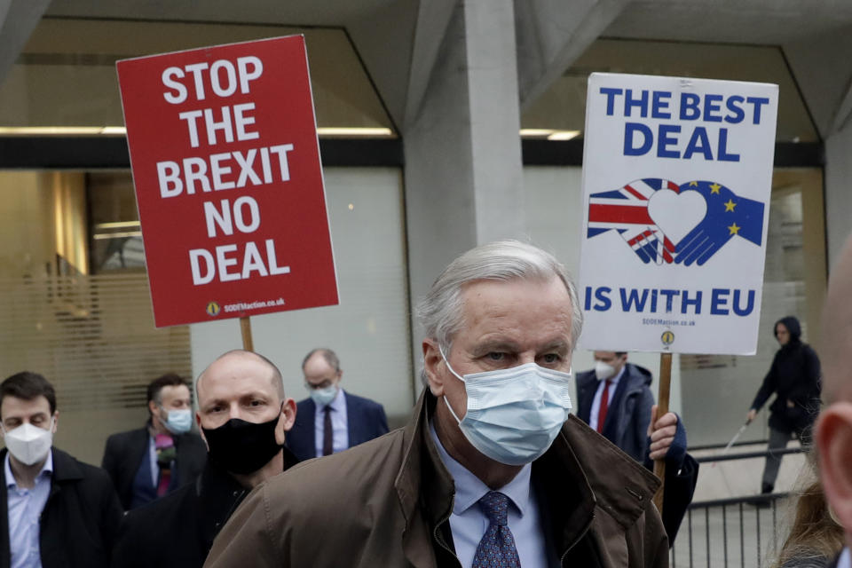 EU chief negotiator Michel Barnier walks with his team to Brexit negotiations at a conference centre in London, on 30 November. Photo: Matt Dunham/AP