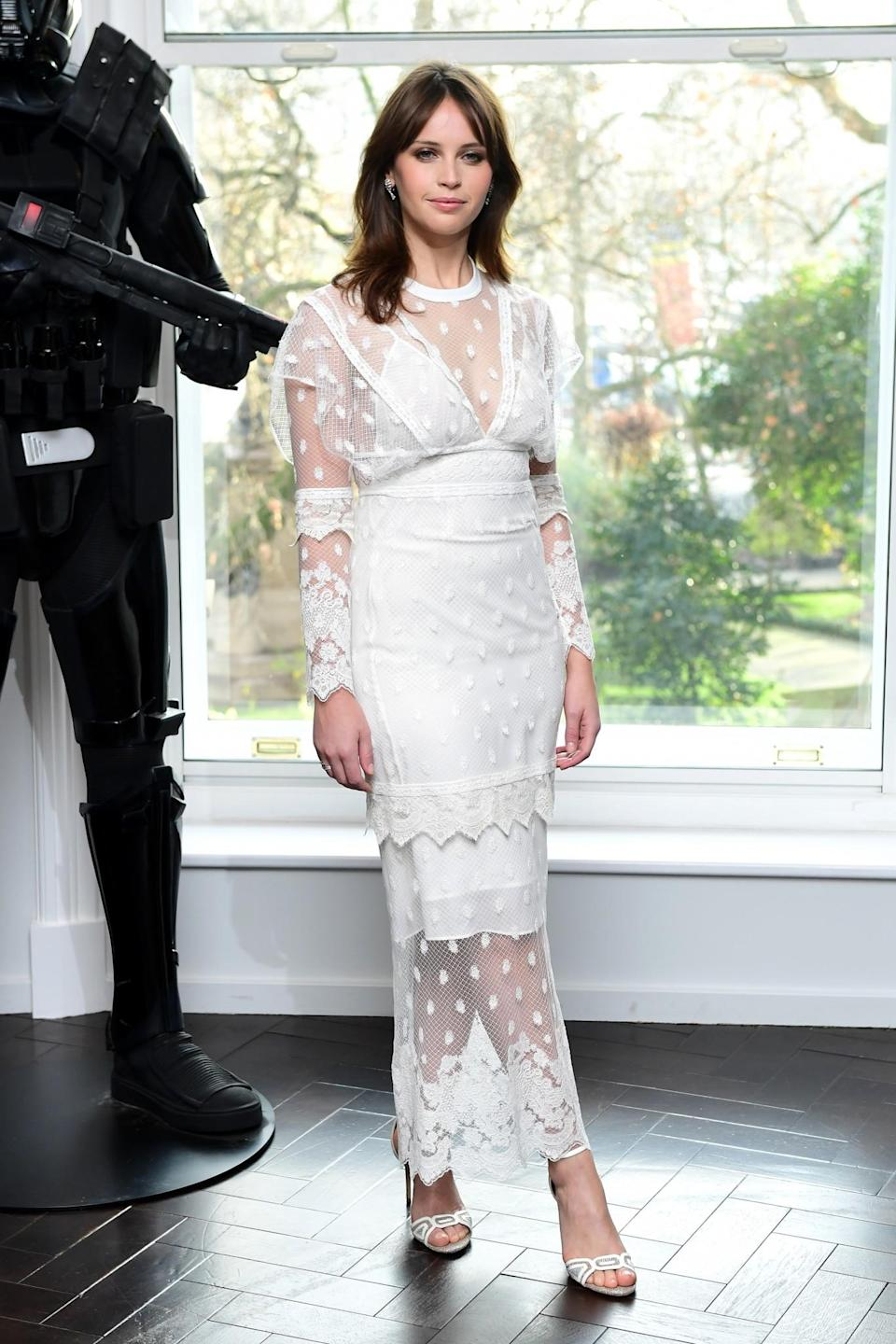 <p>Joining her co-stars at the city's Corinthia Hotel, the actress worked the winter white trend in a lace, semi-sheer dress. [Photo: PA] </p>