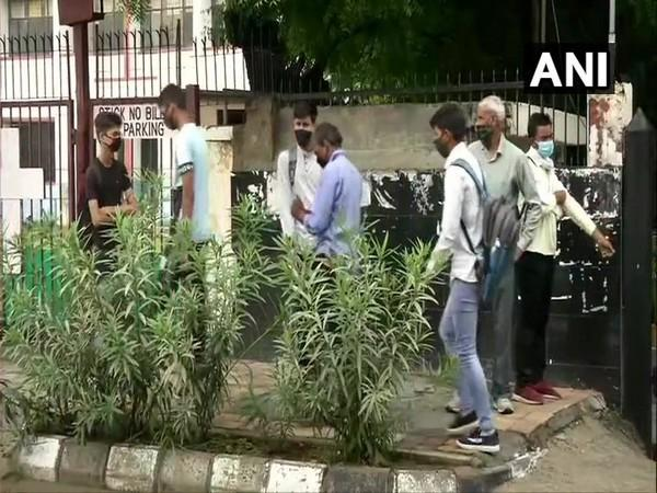 Candidates outside an exam centre in New Delhi on Sunday. (Photo/ANI)