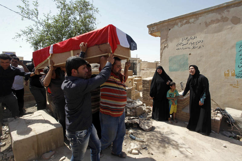 A bombing victim, Bashar Muhsin, 28, is taken for burial in Najaf, 100 miles (160 kilometers) south of Baghdad, Iraq, Monday, April. 29, 2013. Five car bombs exploded Monday in predominantly Shiite cities and districts in central and southern Iraq, killing and wounding dozens of people, police said. (AP Photo/Alaa al-Marjani)