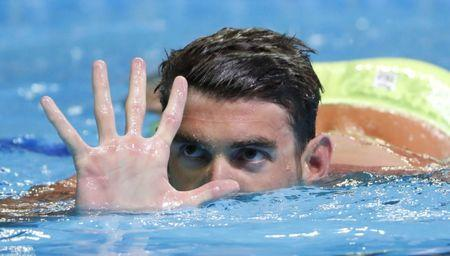FILE PHOTO: Jun 29, 2016; Omaha, NE, USA; Michael Phelps holds up five fingers during the finals for the men's 200 meter butterfly in the U.S. Olympic swimming team trials at CenturyLink Center. Mandatory Credit: Erich Schlegel-USA TODAY Sports