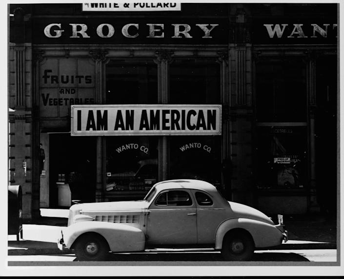 The Japanese owner of this grocery store in Oakland, California displays a sign reminding pedestrians of his loyalties to America, and not Japan, in 1944. | Library of Congress/Corbis/VCG/Getty Images