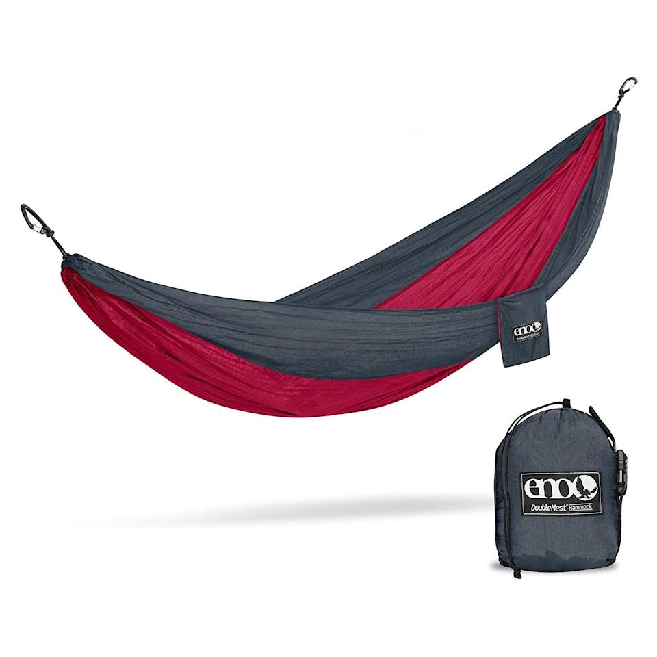 """Weekend visits to the park are about to get a serious upgrade with this two-person hammock. It comes in 40 colors, so there's a shade for every personality, and it conveniently rolls up into a tiny ball, so they won't have to worry about storing it. $70, Amazon. <a href=""""https://www.amazon.com/ENO-Outfitters-DoubleNest-Portable-Charcoal/dp/B074N9RTFT/ref=sr_1_5?"""" rel=""""nofollow noopener"""" target=""""_blank"""" data-ylk=""""slk:Get it now!"""" class=""""link rapid-noclick-resp"""">Get it now!</a>"""
