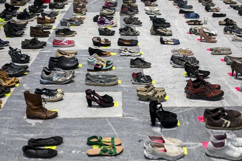 Empty pairs of shoes sit outside the Capitol building in San Juan, Puerto Rico, during a June 1, 2018, protest against the government's reporting of the death toll from Hurricane Maria. (Bloomberg via Getty Images)