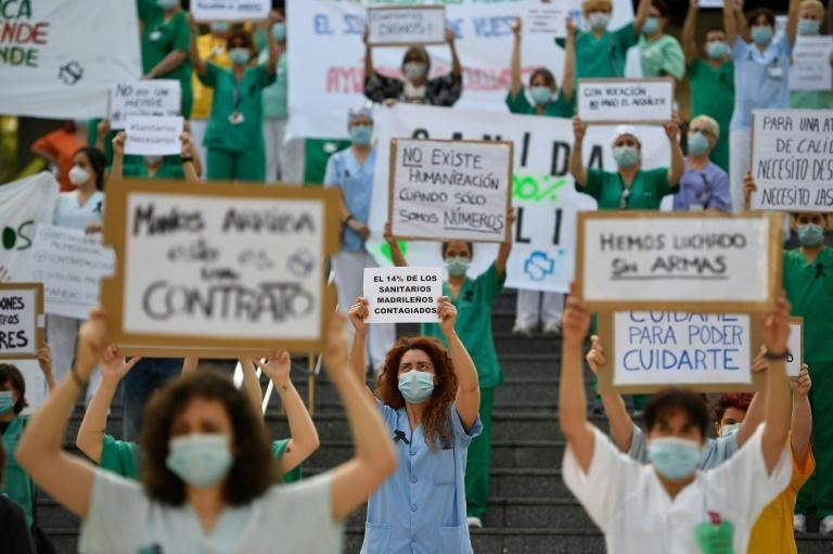 Spanish healthcare workers call for a reinforced healthcare system outside the Gregorio Maranon hospital in Madrid