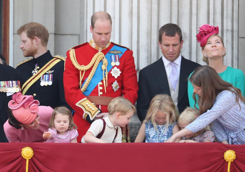 LONDON, ENGLAND - JUNE 17:  (L-R) Catherine, Duchess of Cambridge, Prince Harry, Princess Charlotte of Cambridge, Prince William, Duke of Cambridge, Prince George of Cambridge, Peter Phillips, Savannah Phillips, Isla Phillips and Autumn Phillips look out from the balcony of Buckingham Palace during the Trooping the Colour parade on June 17, 2017 in London, England.  (Photo by Chris Jackson/Getty Images)