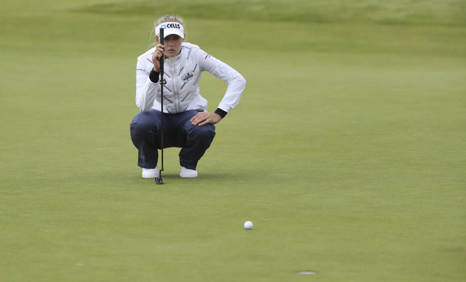 United States' Nelly Korda looks at her putt on the 18th green during the first round of the Women's British Open golf championship, in Carnoustie, Scotland, Thursday, Aug. 19, 2021. (AP Photo/Scott Heppell)