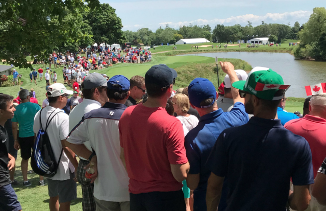 Fans gathered around the first tee at Glen Abbey golf course in Oakville, Ontario.