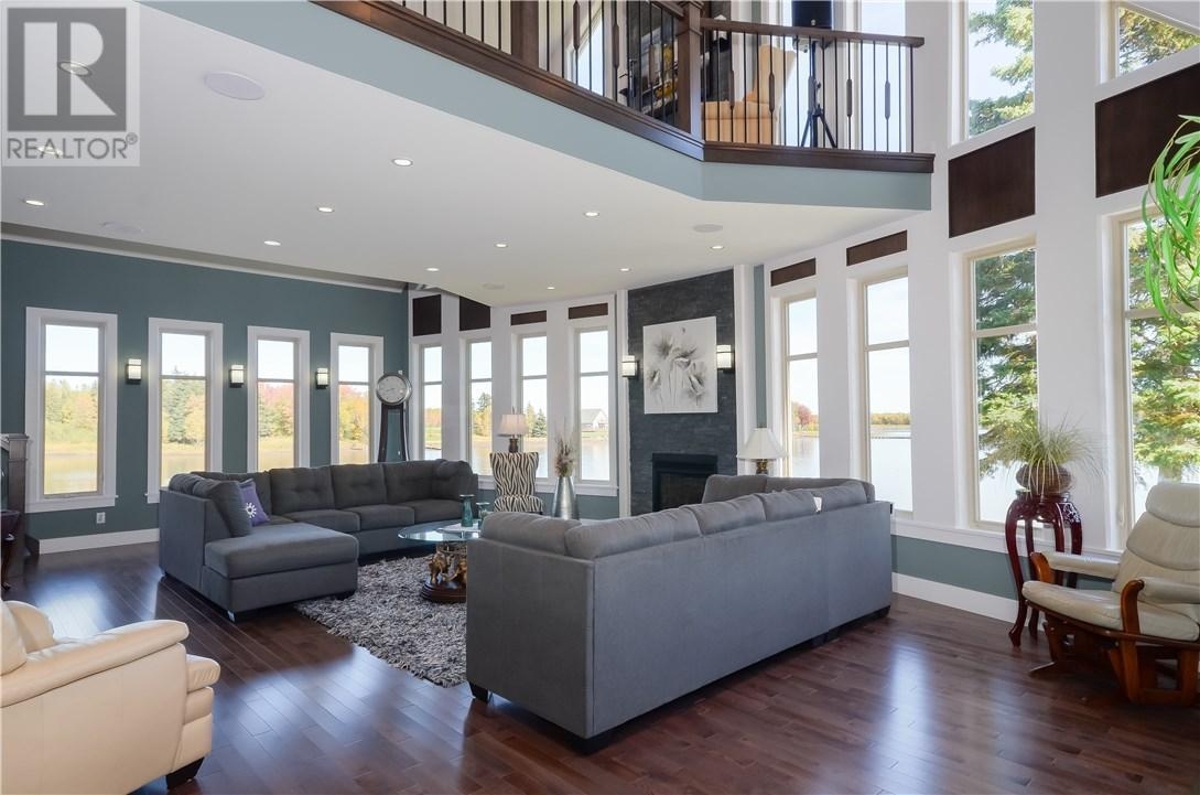 """<p><a rel=""""nofollow"""">57 Clear View Rd., Grand Barachois, N.B.</a><br /> This 6,128-square-foot home sits at the end of a dead-end street, and offers lake views throughout the main floor.<br /> (Photo: Zoocasa) </p>"""
