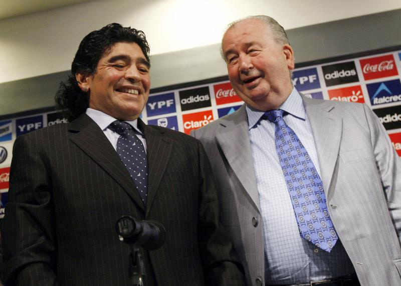 Argentina's national soccer team coach Diego Maradona laughs next to Argentina Football Association President and FIFA Vice President Julio Grondona (R) at Argentine squad's camp on the outskirts of Buenos Aires in this November 4, 2008 file photo. Grondona, aged 82, died July 30, 2014, at a medical centre in Buenos Aires as he was about to undergo heart surgery. REUTERS/Marcos Brindicci/Files (ARGENTINA - Tags: OBITUARY SPORT SOCCER)