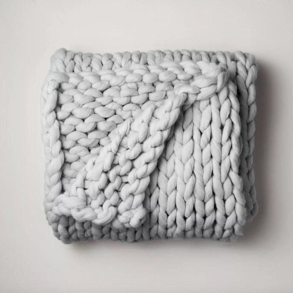 "If they're going to be hibernating, let's at least be chic about it: This chunky knit blanket is <em><strong>ready</strong></em> for full weekends spent <a href=""https://www.glamour.com/gallery/best-romantic-movies-on-netflix?mbid=synd_yahoo_rss"" rel=""nofollow noopener"" target=""_blank"" data-ylk=""slk:Netflix"" class=""link rapid-noclick-resp"">Netflix</a> bingeing. $80, Target. <a href=""https://www.target.com/p/50-34-x-70-34-oversized-chunky-hand-knit-decorative-bed-throw-light-gray-casaluna-8482/-/A-78631731"" rel=""nofollow noopener"" target=""_blank"" data-ylk=""slk:Get it now!"" class=""link rapid-noclick-resp"">Get it now!</a>"