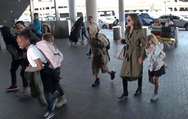 The children reportedly spent time with Brad before jetting off. Source: Backgrid