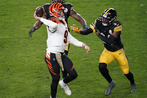 Cincinnati Bengals quarterback Joe Burrow (9) looks to throw a pass with Pittsburgh Steelers strong safety Terrell Edmunds (34) defending during the first half of an NFL football game, Sunday, Nov. 15, 2020, in Pittsburgh. (AP Photo/Keith Srakocic)