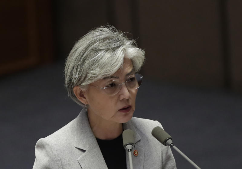 "FILE - In this Tuesday, July 9, 2019, file photo, South Korean Foreign Minister Kang Kyung-wha answers questions during a plenary session at National Assembly in Seoul, South Korea. South Korea said Thursday, July 11, 2019, Kang discussed the issue with U.S. Secretary of State Mike Pompeo by phone and conveyed Seoul's view that Japan's ""undesirable"" trade curbs could disrupt global supply chains and hurt trilateral cooperation among the countries. (AP Photo/Lee Jin-man, File)"