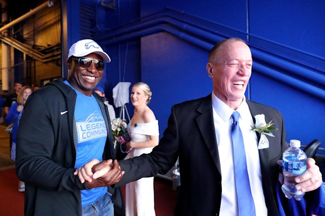 """Ex-Bills Bruce Smith and Jim Kelly talk before halftime of the game against the <a class=""""link rapid-noclick-resp"""" href=""""/nfl/teams/new-england/"""" data-ylk=""""slk:Patriots"""">Patriots</a> while the bride prepares for her wedding at New Era Field. (Getty Images)"""
