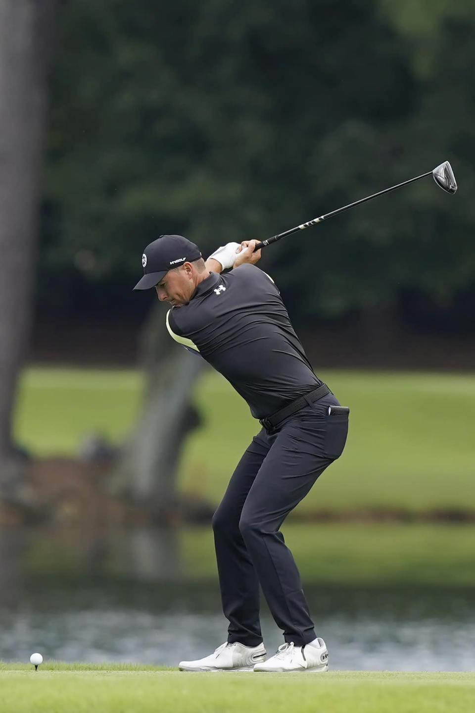 Jordan Spieth hits from the tee on the 16th hole during second round play in the Tour Championship golf tournament at East Lake Golf Club, Friday, Sept. 3, 2021, in Atlanta. (AP Photo/Brynn Anderson)