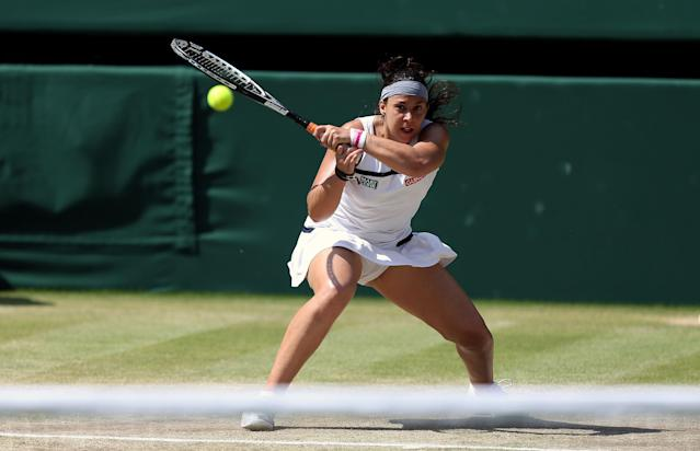 France's Marion Bartoli in action against Germany's Sabine Lisicki during day twelve of the Wimbledon Championships at The All England Lawn Tennis and Croquet Club, Wimbledon.
