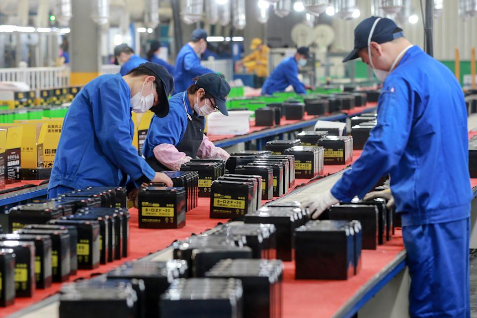 This photo taken on March 30, 2020 shows employees working on a battery production line at a factory in Huaibei in China's eastern Anhui province. - Factory activity in China rebounded in March from a record low, according to official data released on March 31, returning to expansion territory while the coronavirus pandemic continues to devastate the global economy. (Photo by STR / AFP) / China OUT (Photo by STR/AFP via Getty Images)