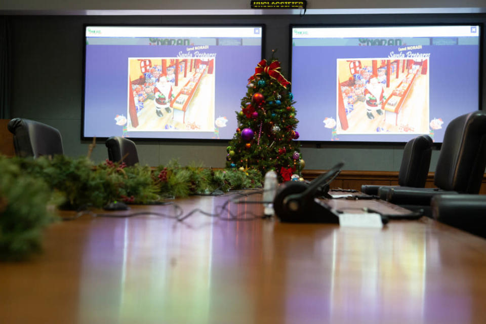 This Dec. 24, 2019 photo provided by The North American Aerospace Defense Command (NORAD) the NORAD tracking Santa Operations Center on Peterson Air Force Base, Colo. This is the 65th year for the U.S.-Canadian operation that has tracked the jolly old man since a child mistakenly called the base asking to speak to Santa. (Tech. Sgt. Jeff Fitzmorris/NORAD via AP)