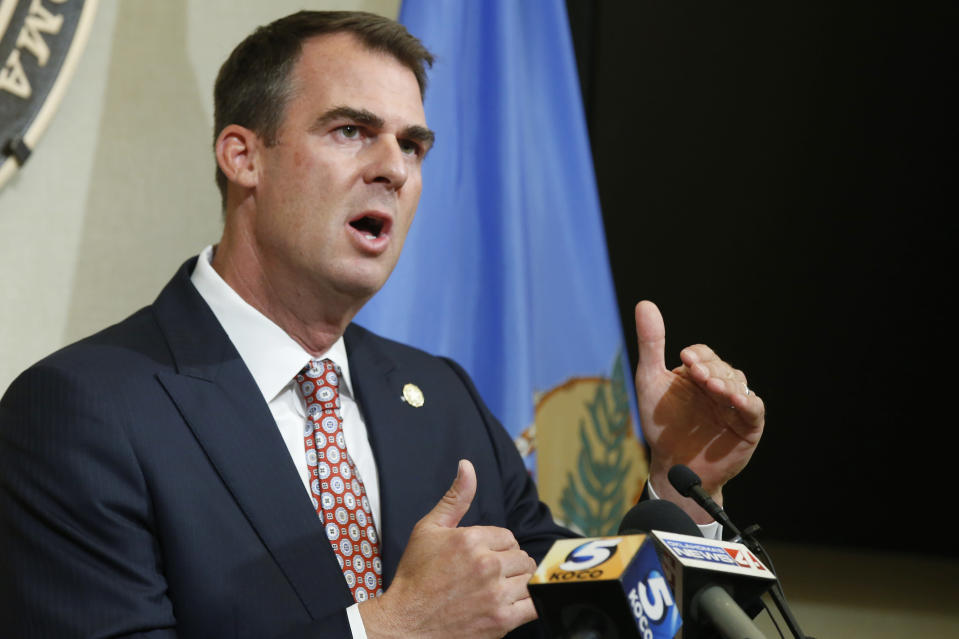 FILE - In this July 9, 2020 file photo, Oklahoma Gov. Kevin Stitt speaks during a news conference in Oklahoma City. Stitt, the first governor in the nation to test positive for the coronavirus, says he has donated plasma to help other virus patients recover. Stitt said in a statement Tuesday, Aug. 11th that he made the donation recently at an Oklahoma Blood Institute center in Enid. (AP Photo/Sue Ogrocki, File)
