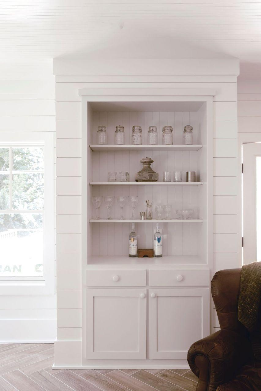 """<p>If you're looking to infuse cozy, old-home charm into a new construction, consider using nickel gap shiplap. This design feature looks just as beautiful on ceilings as it does on walls!</p><p><strong>See more at <a href=""""https://heirloomedblog.com/basement-renovation-reveal/"""" rel=""""nofollow noopener"""" target=""""_blank"""" data-ylk=""""slk:Heirloomed Blog"""" class=""""link rapid-noclick-resp"""">Heirloomed Blog</a>. </strong></p><p><a class=""""link rapid-noclick-resp"""" href=""""https://go.redirectingat.com?id=74968X1596630&url=https%3A%2F%2Fwww.walmart.com%2Fip%2F5-3-8-H-x-5-8-P-x-108-L-Shiplap-Nickel-Gap-Planking-Moulding-PVC%2F763582428&sref=https%3A%2F%2Fwww.thepioneerwoman.com%2Fhome-lifestyle%2Fdecorating-ideas%2Fg34763691%2Fbasement-ideas%2F"""" rel=""""nofollow noopener"""" target=""""_blank"""" data-ylk=""""slk:SHOP NICKEL GAP SHIPLAP""""><strong>SHOP</strong> NICKEL GAP SHIPLAP</a></p>"""