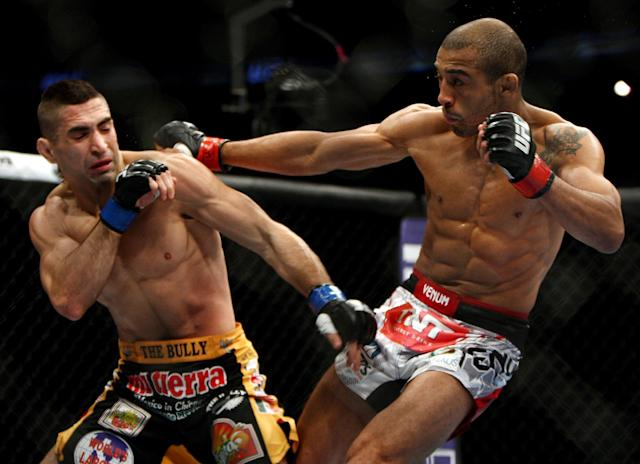 Jose Aldo, right, of Brazil and Ricardo Lamas of Chicago, IL fight in the second round of the Ultimate Fighting Featherweight Championship Mix Martial Arts bout in Newark, N.J. on Saturday, Feb. 1, 2014. Aldo won by unanimous decision in five rounds. (AP Photo/Tim Larsen)