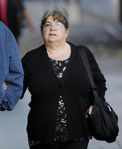 In this Oct. 8, 2013 file photo, Annette Bongiorno, longtime secretary of imprisoned financier Bernard Madoff, arrives to federal court in New York. Bongiorno and four other back-office subordinates of Madoff are accused of aiding the disgraced financier in one of history's biggest frauds. (AP Photo/Seth Wenig, File)