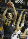 Missouri forward Ryan Rosburg (44) shoots against the defense of South Carolina forward Michael Carrera (24) during the second half of an NCAA college basketball game in the first round of the Southeastern Conference tournament, Wednesday, March 11, 2015, in Nashville, Tenn. (AP Photo/Mark Humphrey)