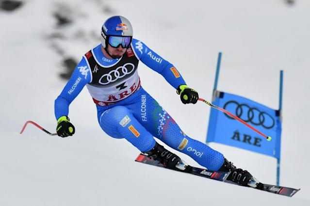 Paris powered to his maiden world title in Wednesday's super-G (AFP Photo/Fabrice COFFRINI)