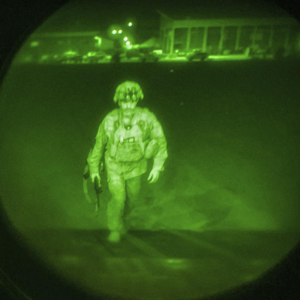 A night vision picture of Major General Chris Donahue, commander of the US Army 82nd Airborne Division, XVIII Airborne Corps, boards a C-17 cargo plane at Hamid Karzai International Airport in Kabul as the final American service member to depart Afghanistan (US Central Command via AP)