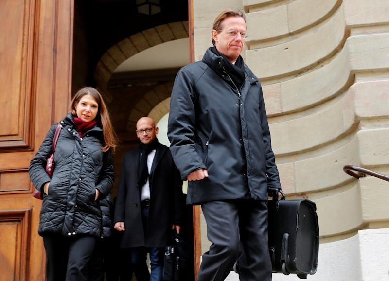 Christian Luescher (R) lawyer for Vitaly Malkin, walks out of the courthouse after the verdict of the trial of Patrice Lescaudron a Credit Suisse banker in Geneva, Switzerland, February 9, 2018. REUTERS/Denis Balibouse - RC120683DC60