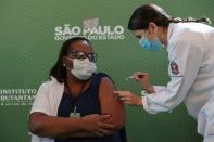 Health workers receive China's Sinovac coronavirus disease (COVID-19) vaccine, in Sao Paulo