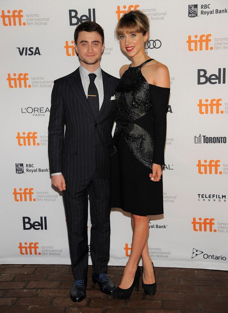 """Daniel Radcliffe, left, and Zoe Kazan arrive at the premiere of """"The F Word"""" on day 3 of the Toronto International Film Festival at the Ryerson Theatre on Saturday, Sept. 7, 2013, in Toronto. (Photo by Chris Pizzello/Invision/AP)"""